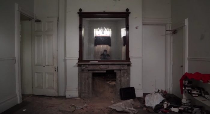 In the video, a shadow can be seen in doorway that may be this unexpected tenant.