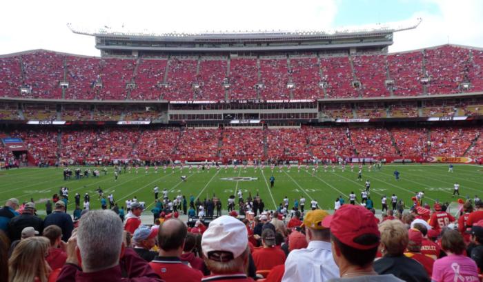 8. Cheer softly at a football game.