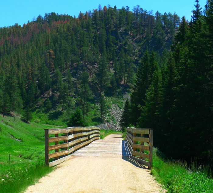 The trail explores the Black Hills along the path of the tracks for 108.8 miles, beginning in Edgemont and ending in Deadwood with plenty of trailheads in between.