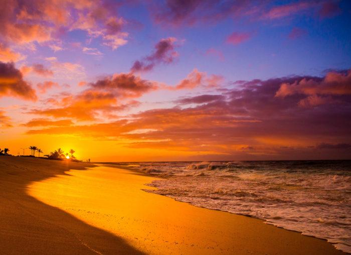 10. Take a sunrise walk along the beach.