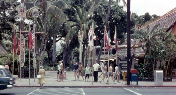 2. Tourists hang out in front of the International Marketplace in Honolulu.
