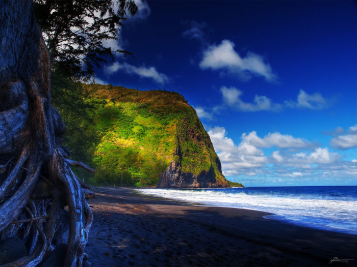 While the blue waters lapping against the black sand might seem inviting, the surf can be pretty rough here, so take warning, and maybe only dip your feet in a little.
