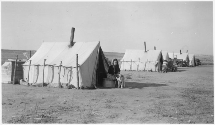 7. Winter in a tent city for the workers and their families working on the Oglala Dam project, 1941