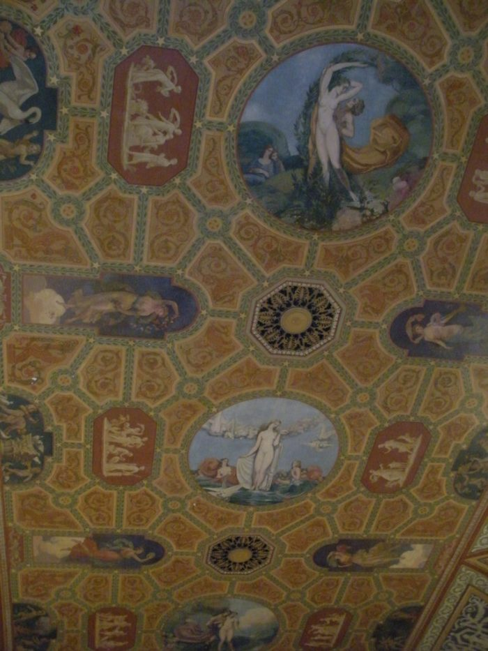 The ceiling has a mural depicting Greek mythology.