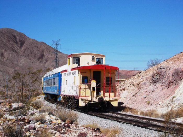 Behind the casino, you'll find train tracks and the popular River Mountains trailhead.