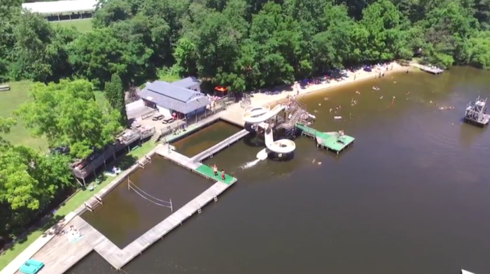 This aerial view reveals what the park has to offer including a water slide, several diving platforms, a beach, and more. They also offer a splash park (not pictured).