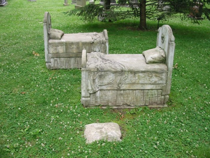 These headstones shaped like tiny beds are an especially heartbreaking sight.