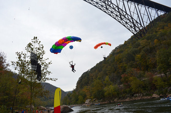 People BASE jump and rappel from the bridge.