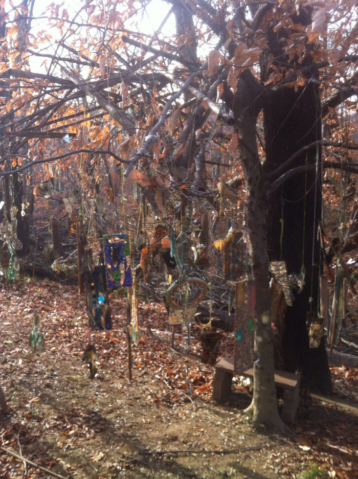 The trees are ornamented with old bicycle parts or decorative mirrors that give a creepy but cool vibe to the whole place.
