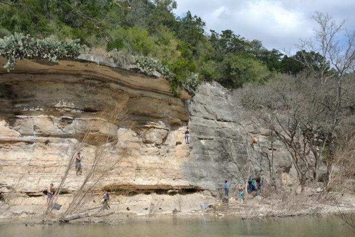 The limestone bluffs are popular with climbers.