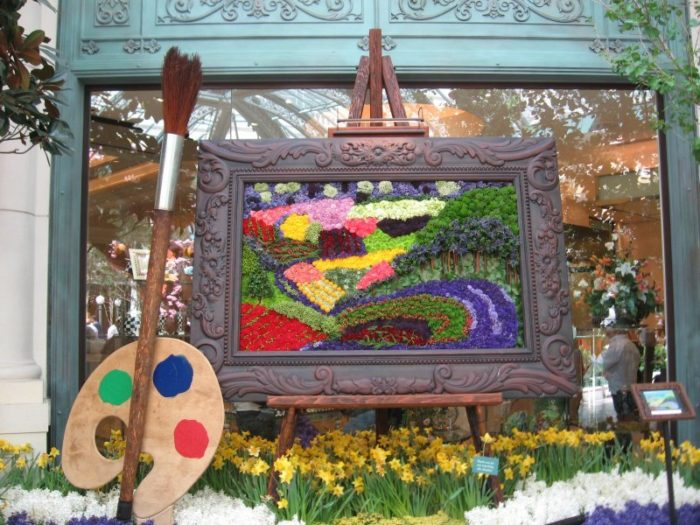 Covering 14,000 square feet, the indoor wonderland creates beautiful works of art out of floral features.
