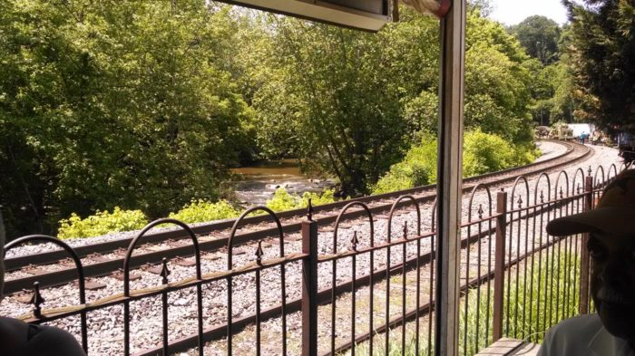 In between train sightings, the outdoor area is quiet and serene, overlooking the Patapsco River.
