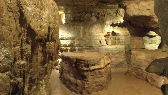 """It is believed that the Wyandotte Indians once used the caverns as shelter from the weather and their enemies. Pictured is the room that contains  """"Council Rock,"""" where the council met and the flat rock on the floor functioned as a work bench."""