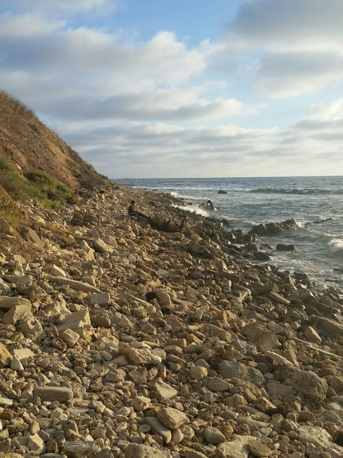 Once you reach the shoreline you'll follow along this rocky path. Be very careful as the rocks can be challenging to navigate and slick when wet.