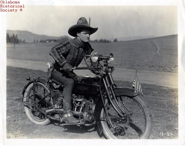 """5. Tom Mix riding a Henderson motorcycle in the 1919 film, """"Hell Roarin' Reform"""" – directed by Edward LeSaint."""