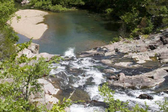 This Ozark waterfall swimming hole is a hidden gem in The Show Me State, and a perfect spot to spend a hot summer day.