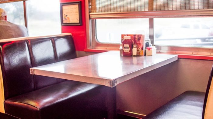 You can either sit in an old-fashioned diner booth...