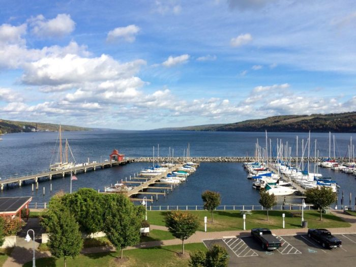 Look out your window and you'll have a view of the Seneca Lake harbor and pier.