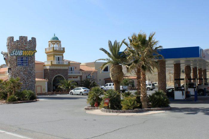 This is no mirage. It's a palm-tree-laden rest stop with gas pumps, a convenience store, motel and Subway restaurant ...