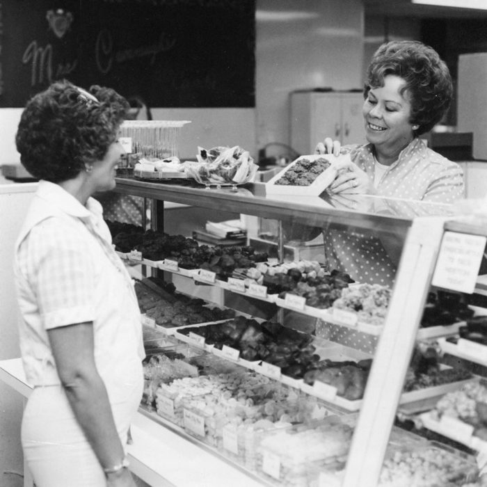 Here's a photo of Mrs. Cavanaugh in her first store over 50 years ago!