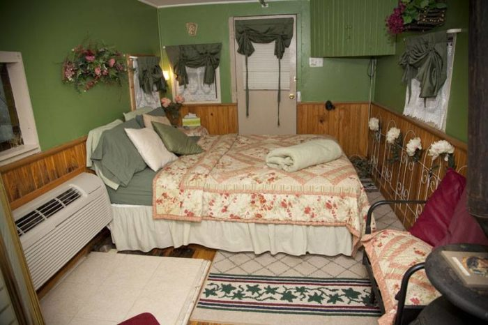 Homey beds are part of the charm in these refurbished cabooses.