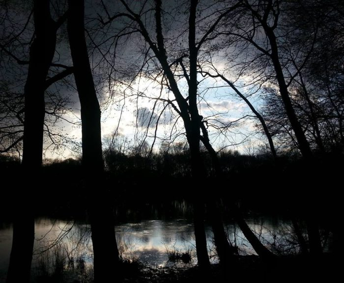 """The killer was never caught, but the ghost of the distraught runaway still lingers here.  Visitors to this area often hear footsteps in the woods around the pond. Some hear a young girl's voice saying, """"no..."""" and """"please..."""""""