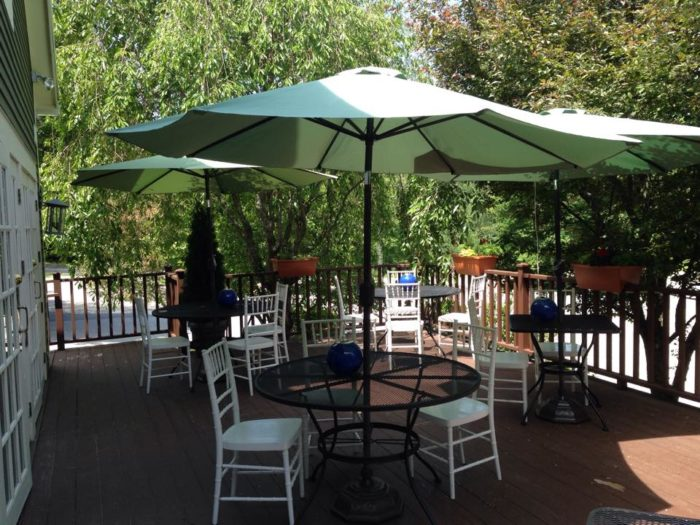 The outdoor seating puts you under a canopy of leaves.