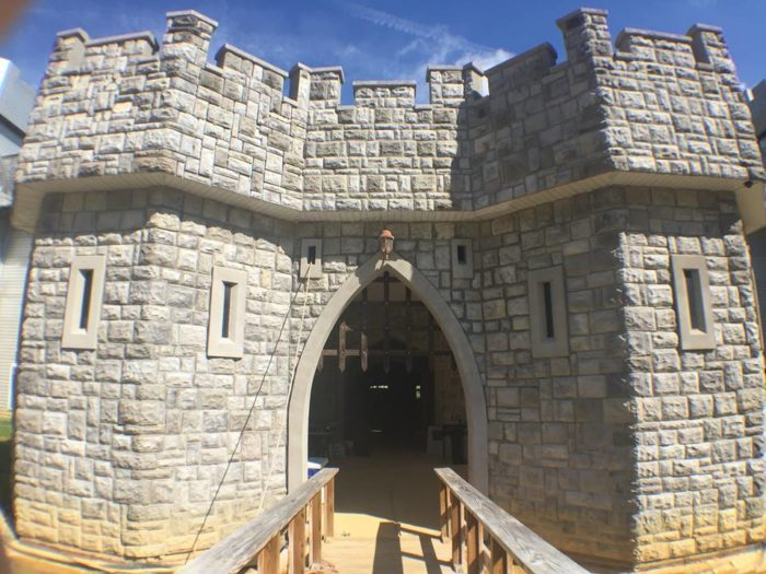 Inside the castle, there are one-of-a-kind fixtures fit for any King or Queen—drawbridge-style doors, sconces, and more!
