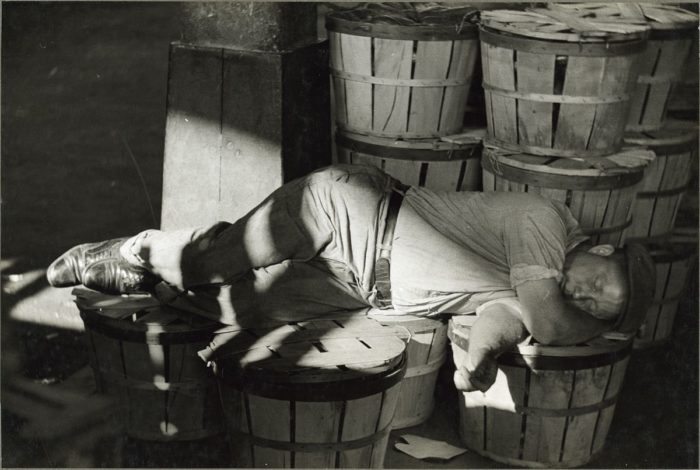 8. This man sleeps in a Baltimore fish market in 1938.