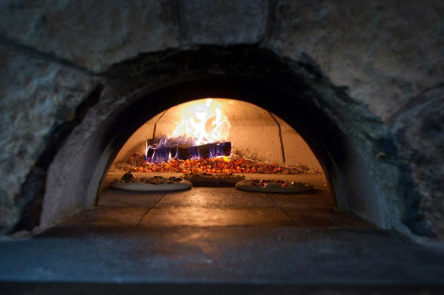 Wood fired pizza is done to a perfection.