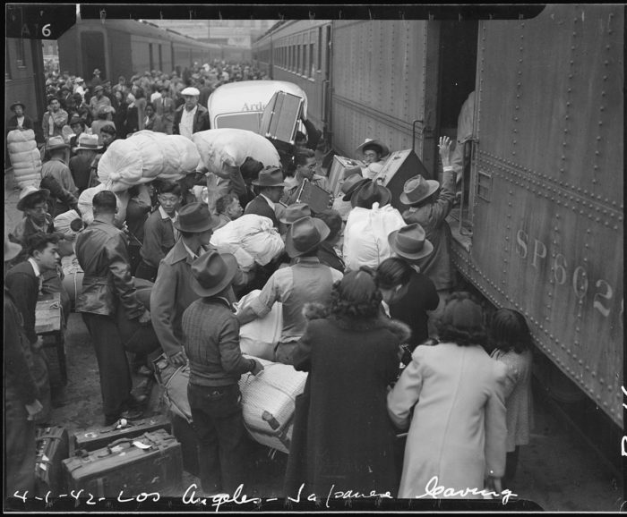 2. This photo taken in Los Angeles captures a crowd of Japanese-American evacuees boarding a train taking them to a war relocation center far away from their home. Such a tragic time in history.