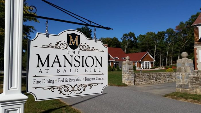 The Mansion at Bald Hill is a stately mansion with antique furnishings.