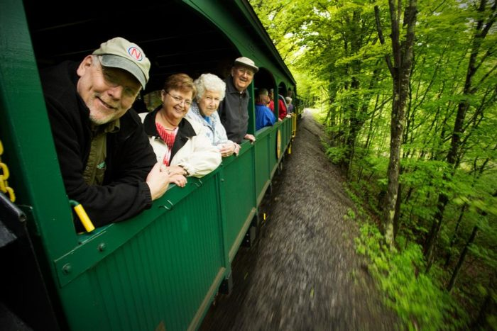 The train cars are open air, so you'll feel like part of the great outdoors!