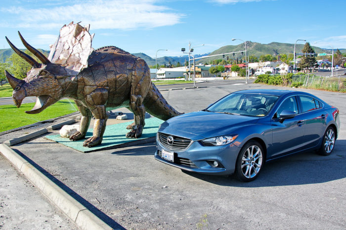 4. Park that mammoth dinosaur of an SUV you drive next to our car.