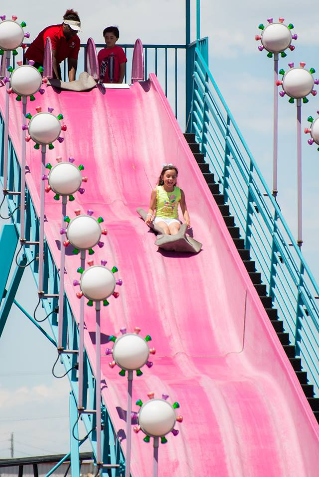 Glide down three stories of glee on the grin-inducing giant slide!