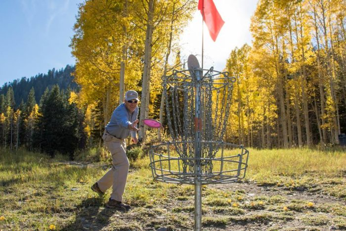 7. Play a round of disc golf.