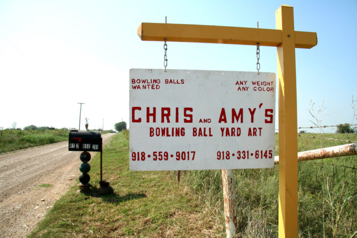 Bowling Ball Yard Art is located 1 mile north and 1 mile east of Nowata on Road 021. Look for the signs to direct you.