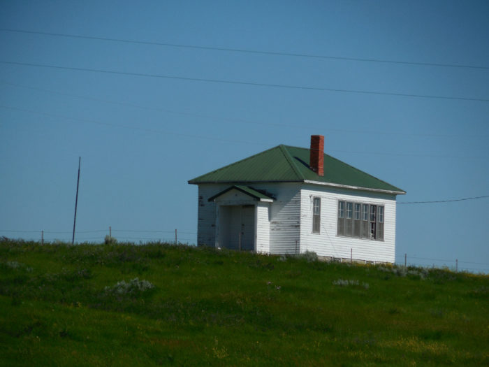 7. Perched on a hill is this old school in Red Elm, South Dakota