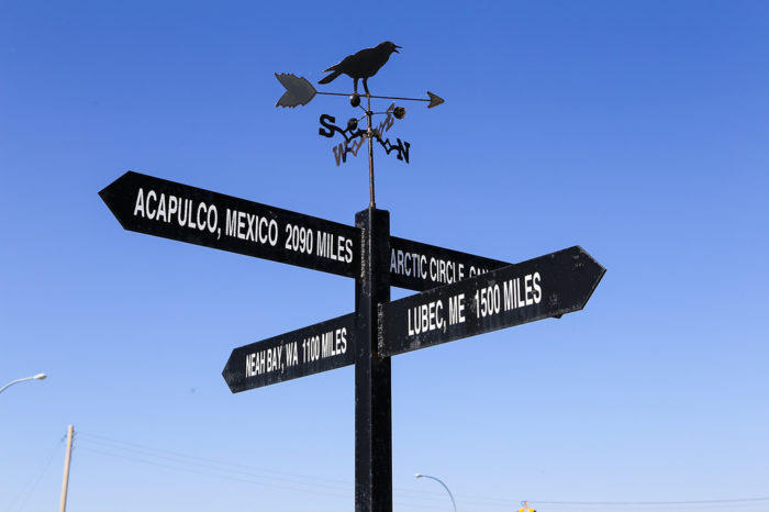 This sign there has markers pointing to each of the farthest reaches of the continent in every direction