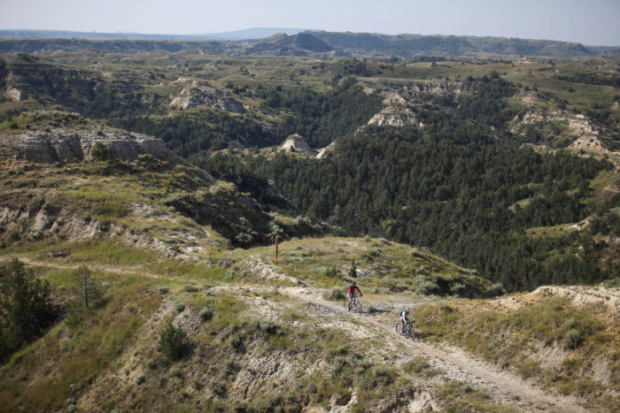 6. Bike or hike the Maah Daah Hey Trail through the rugged terrain of Theodore Roosevelt National Park