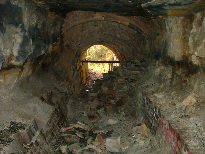 You'll notice a pile of bricks in the entryway of the tunnel, but you can climb over them (carefully) if you're brave enough.