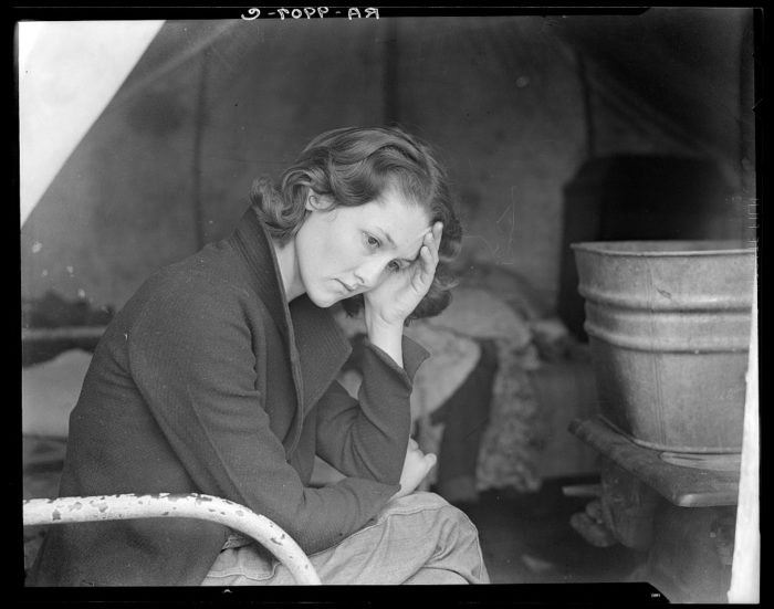 6. This young girl is a daughter of a Tennessee coal miner. It's 1936 and she's living in a camp alongside the American River after travelling by wagon.