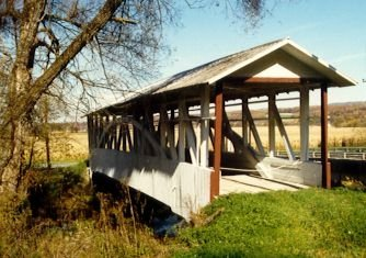 The Bowser/Osterburg Covered Bridge crosses over Bob's Creek and is now simply a piece of artwork against the landscape. Shut down in 1975, the bridge is protected by a cable to deter passers-by from attempting to pass over it.