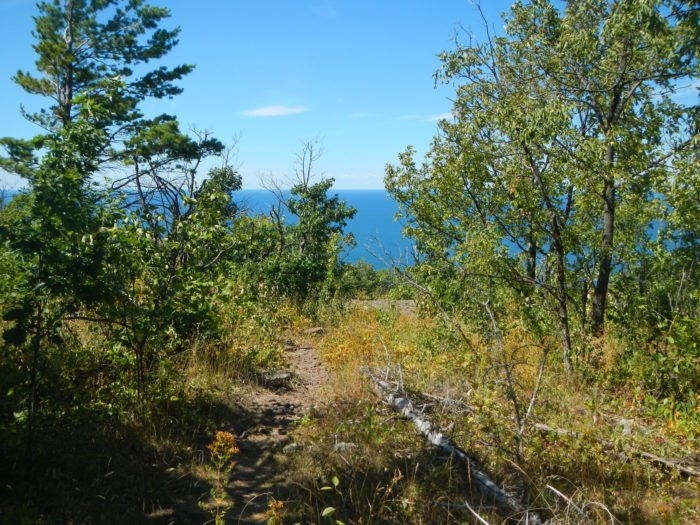 At a few points throughout the hike, you'll be treated to a glimpse of Lake Superior in the distance. Snap a few photos before heading back to the trailhead.