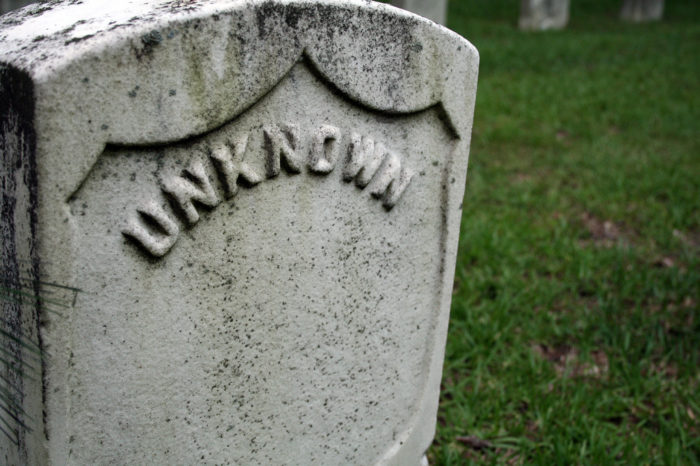 """Many of the graves are marked with only numbers or """"Unknown."""""""