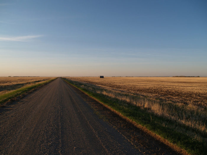 6. The huge expanse of fields and sky on this country road through Deep, North Dakota, a ghost town that is completely wiped off the map