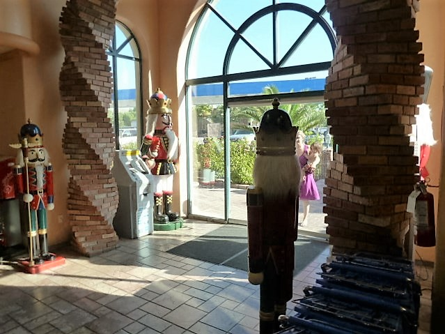 You  take a break from the road and enter the front lobby of Death Valley Nut & Candy Co., only to be welcomed by life-sized nutcracker dolls (and an ATM).