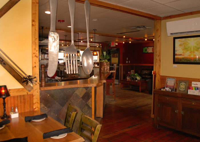 A family-owned restaurant, Out of the Fire Cafe offers a unique dining experience. Guests are welcome to peek into the open kitchen to watch their meals being prepared.