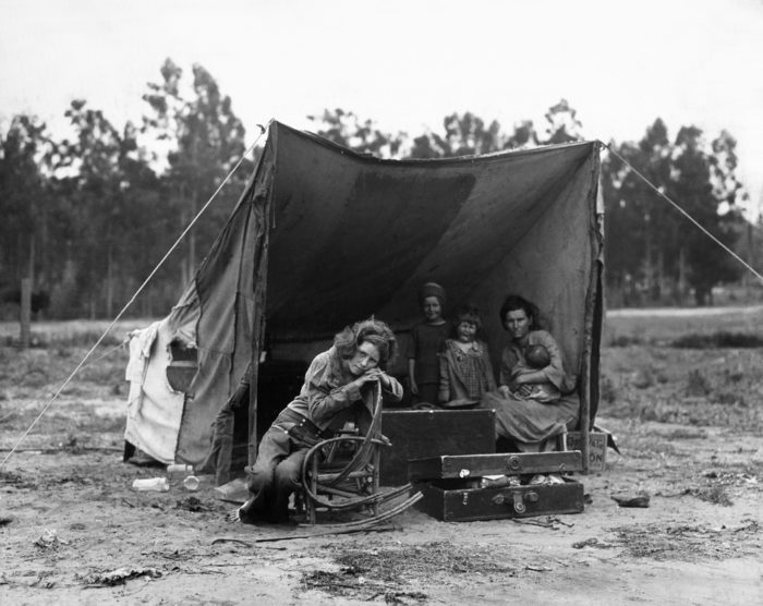 """9. A family barely surviving in 1935 in a makeshift tent in Nipomo, California. This photo was part of the famous """"Migrant Mother"""" series photographed by Dorothea Lange."""