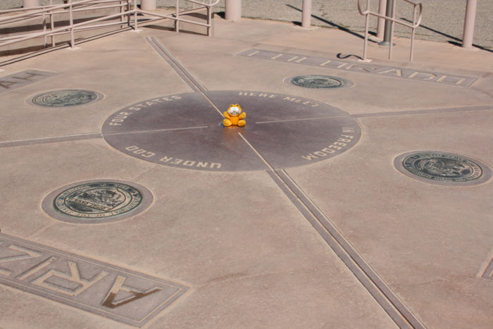 19. Stand (or lie down) in four states at once at Four Corners Monument.
